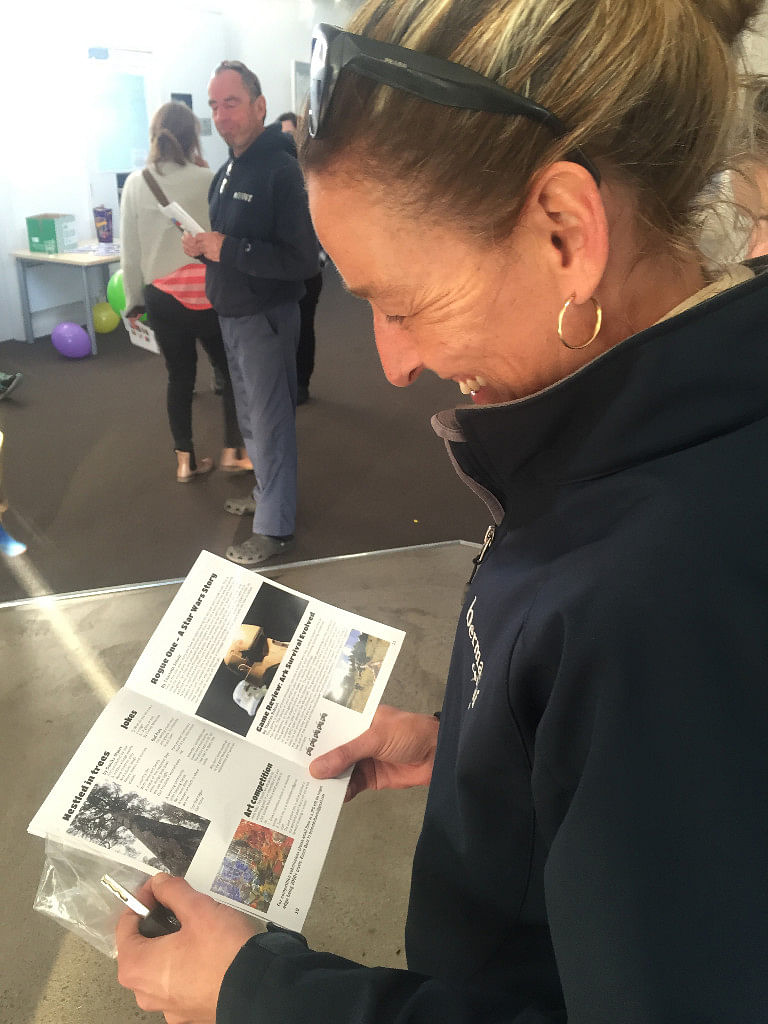 Photograph: A Bermagui resident reads issue one of the Dot�Dot�Dot� magazine.