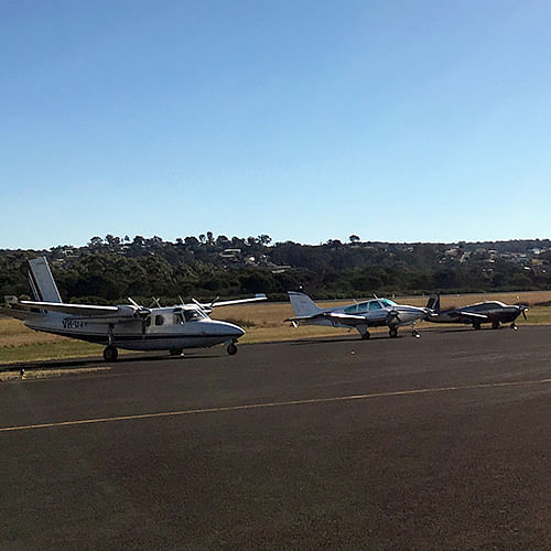 Light planes on the runway at Merimbula airport.