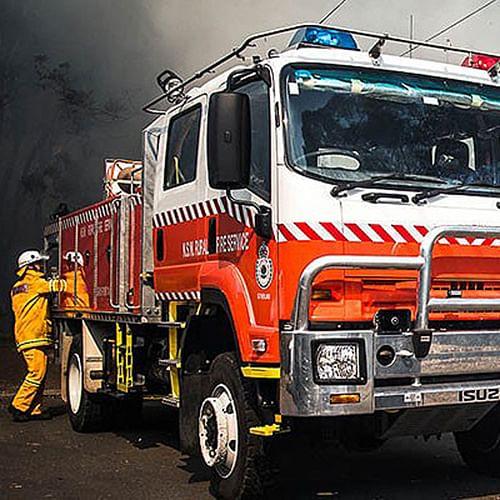 rural fire service fire truck and fireman attending fire