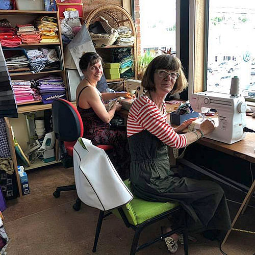People learning to sew at the Bega Funhouse with Boomerang Bags.