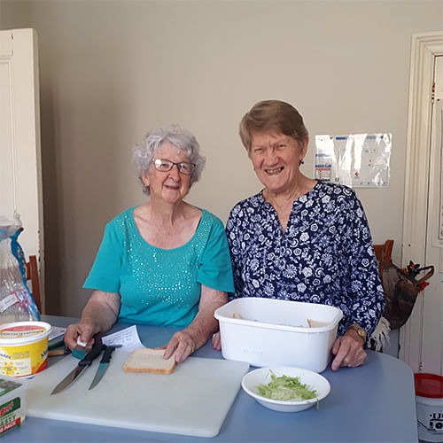 Joan Goldberg and Joyce Smith volunteering at Red Cross in Bega.