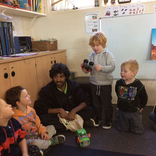 Council's trainee Early Childhood Educator, James Schultz with children at Eden Preschool.