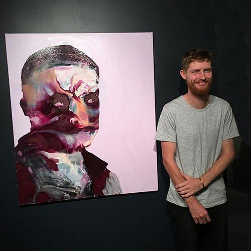2015 winner Liam Ambrose with his work, Portrait of Alan Jones, Artist.
