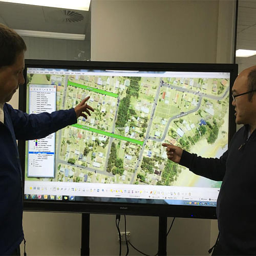 Council�s Asset Systems Analyst, Steve Katona and Asset Management Coordinator, Gary Louie, using the interactive NOC (upright format).
