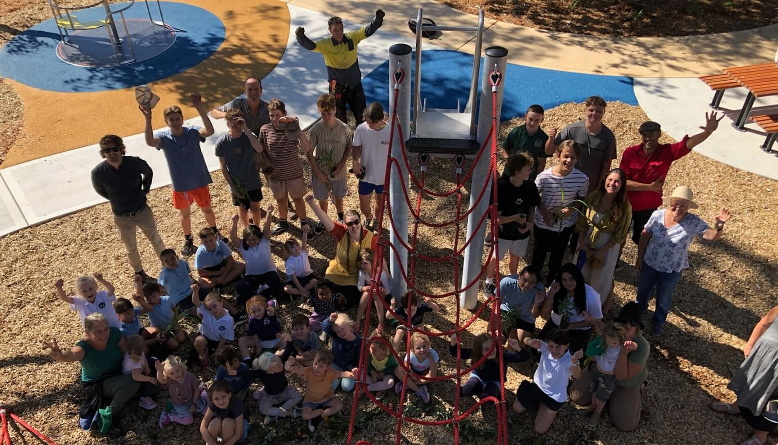 Children from Bermagui Pre-school and Narooma High School, teachers, Council staff and invited guests celebrate the opening of the new Bermagui all-inclusive playground.