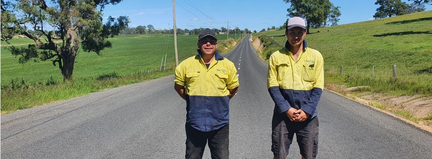 Boundary Road works team members, James Pittman (left) and Darcy Corbett at the Princes Highway entrance to Boundary Road.
