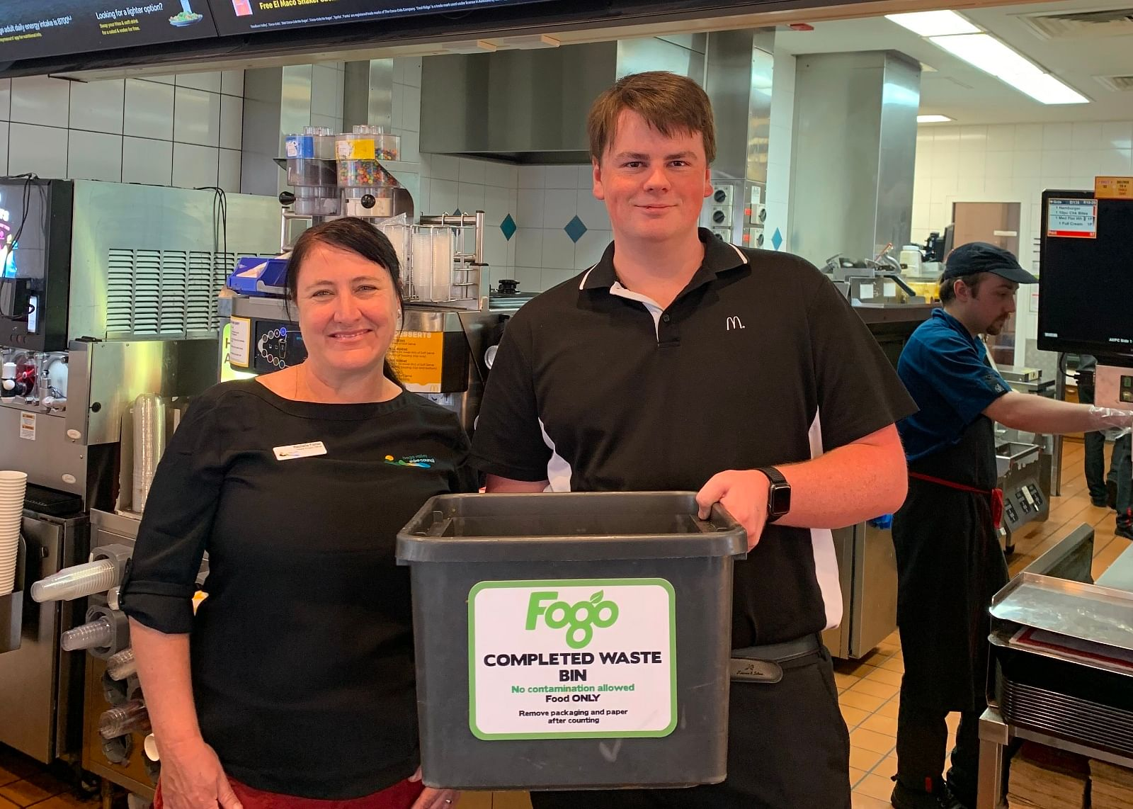 Food waste and FOGO combine for better outcomes at Merimbula's Macca's restaurant. Restaurant Manager, Ryan Fraser and FOGO for Business Project Officer, Rechelle Fisher.