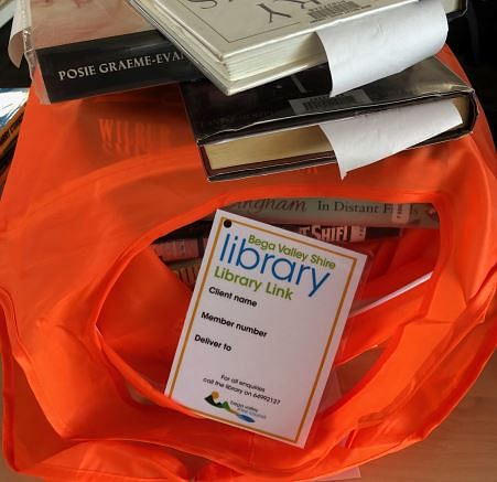 Library books in a REDcycle plastic bag.