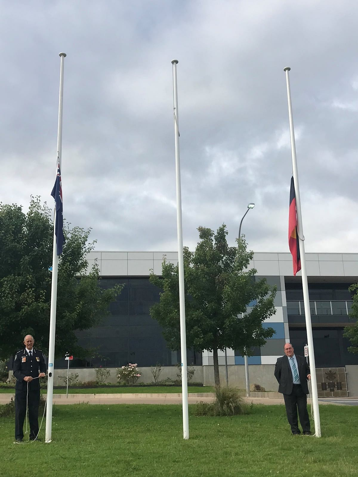 -1. NSW Rural Fire Service Far South Coast District Manager, Superintendent John Cullen and Bega Valley Shire Mayor, Russell Fitzpatrick lowered the flags to half-mast in Littleton Gardens this morning.