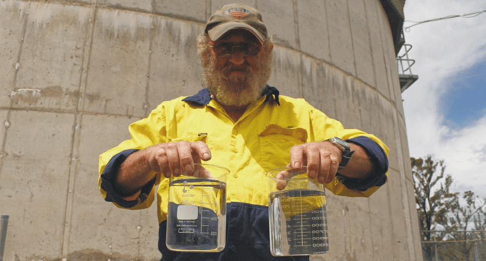Senior treatment plant operator, Rob Jones with a sample of river water cleared using a new sediment reduction process.