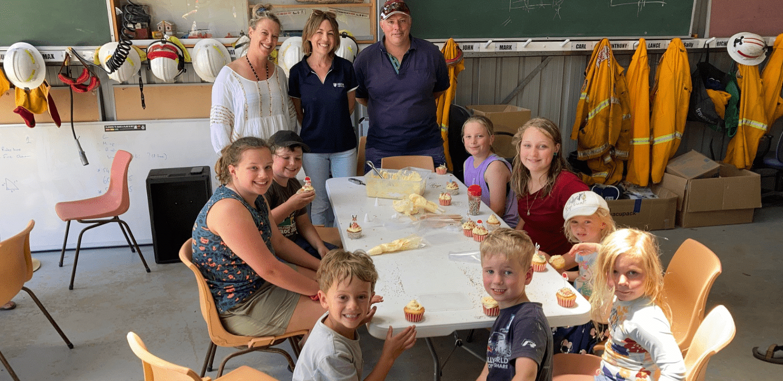 Cupcake decorating at Tathra - (from left) Kelly Eastwood (Eastwood's Deli & Cooking School), Hayley Reynolds (Fortem Australia) and Adam Wiggins (Tathra RFS Captain) with their cupcake decorating champions.