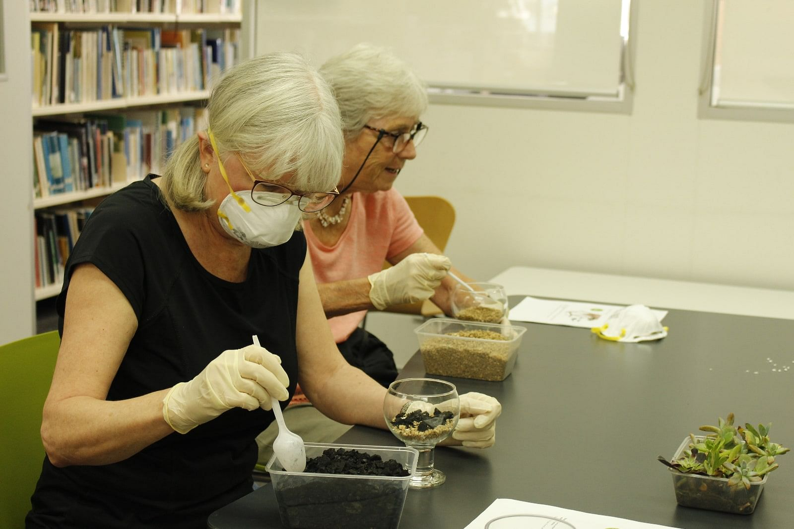 Andrea Olson and Sue Lister enjoy the terrarium-making class at the Bega Valley Shire Library.