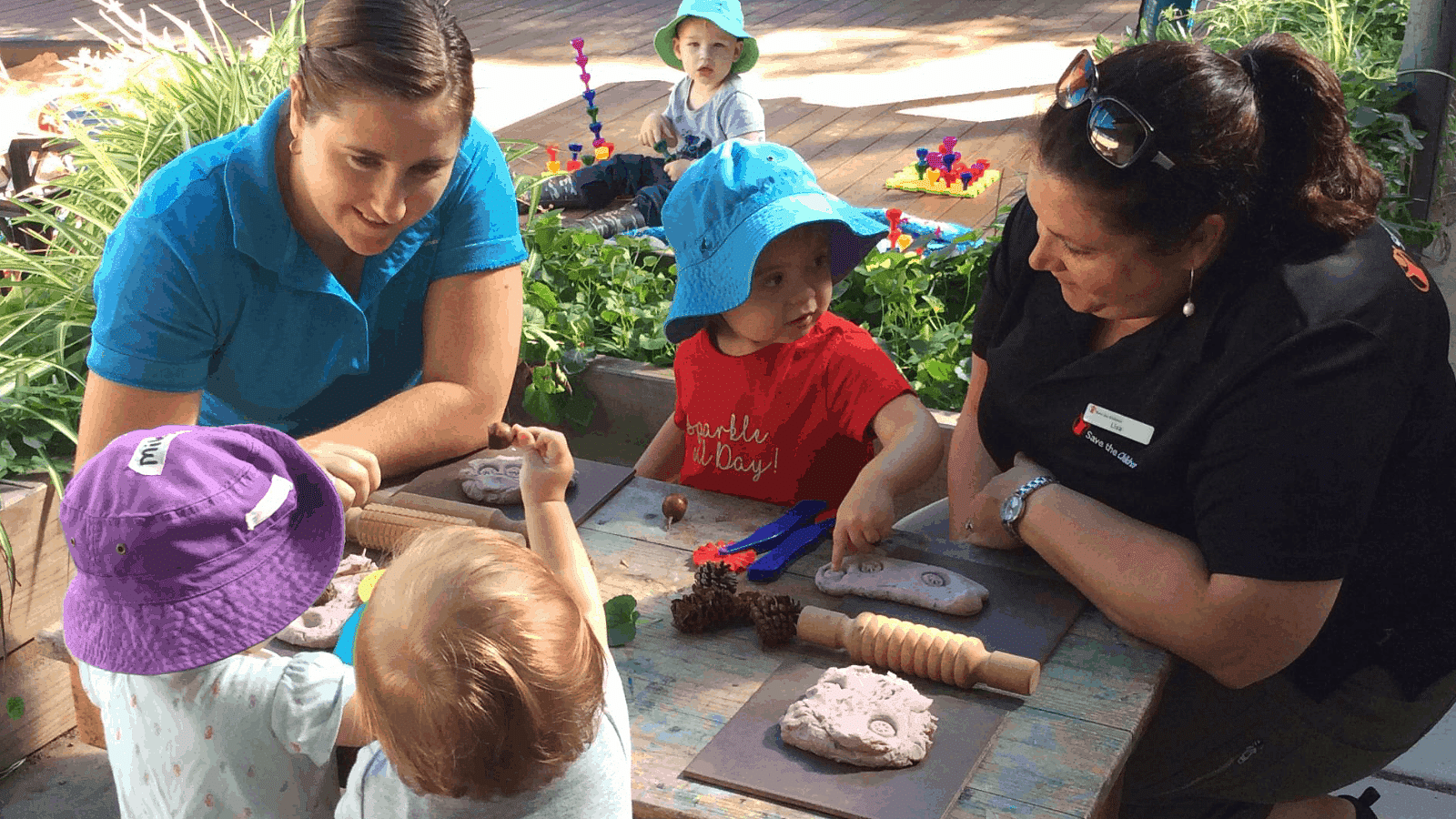 Bandara child care centre staff and children play at crafts.