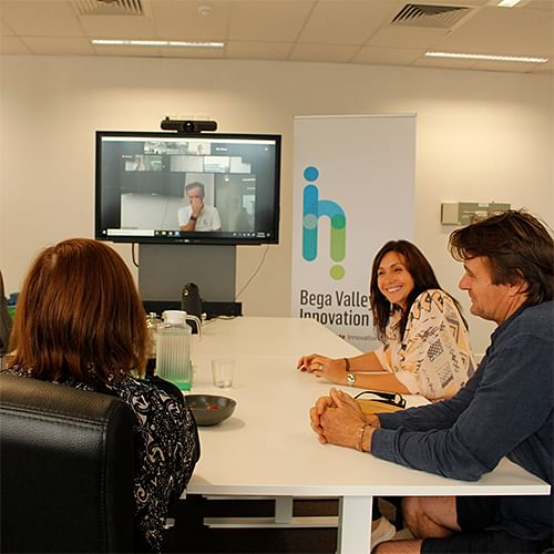 Small business owners participate in a videoconference training session..
