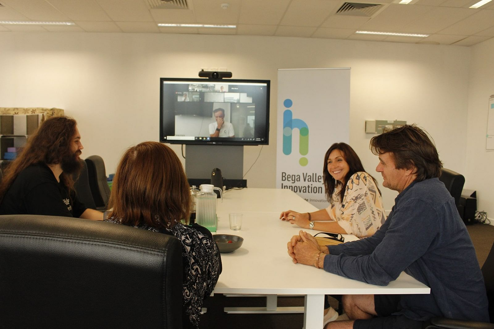 Small business owners participate in a videoconference training session.