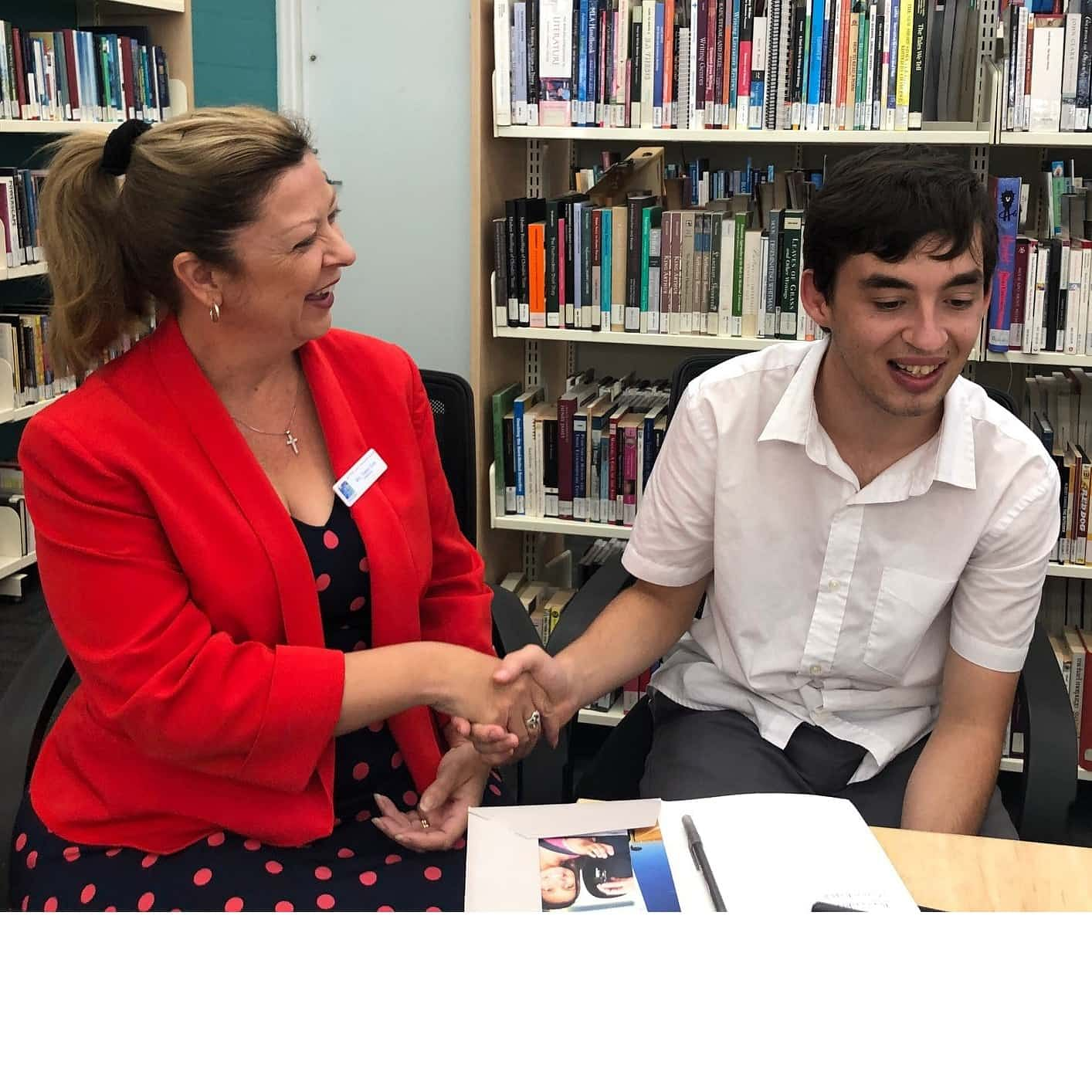 Sapphire Coast Anglican College Principal, Tracey Gray congratulates student Ben Cook for his achievements at Bega Library.