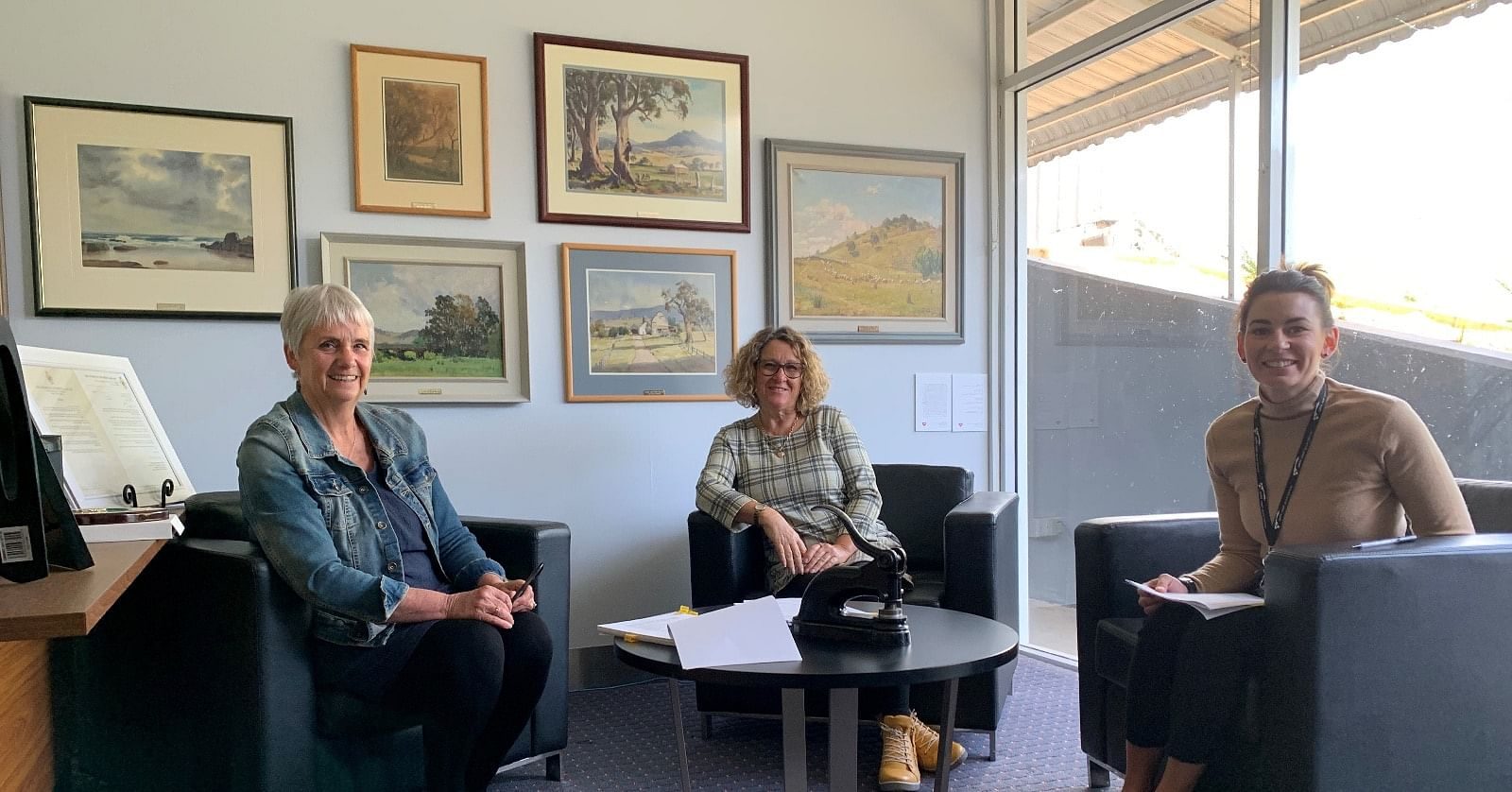 Photo: General Manager Leanne Barnes, Mayor Sharon Tapscott and Property & Facilities Coordinator Rickee Marshall oversee the settlement of the Australasia sale.