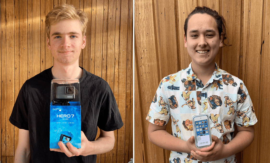Two of the winners of the one minute film festival holding their prizes