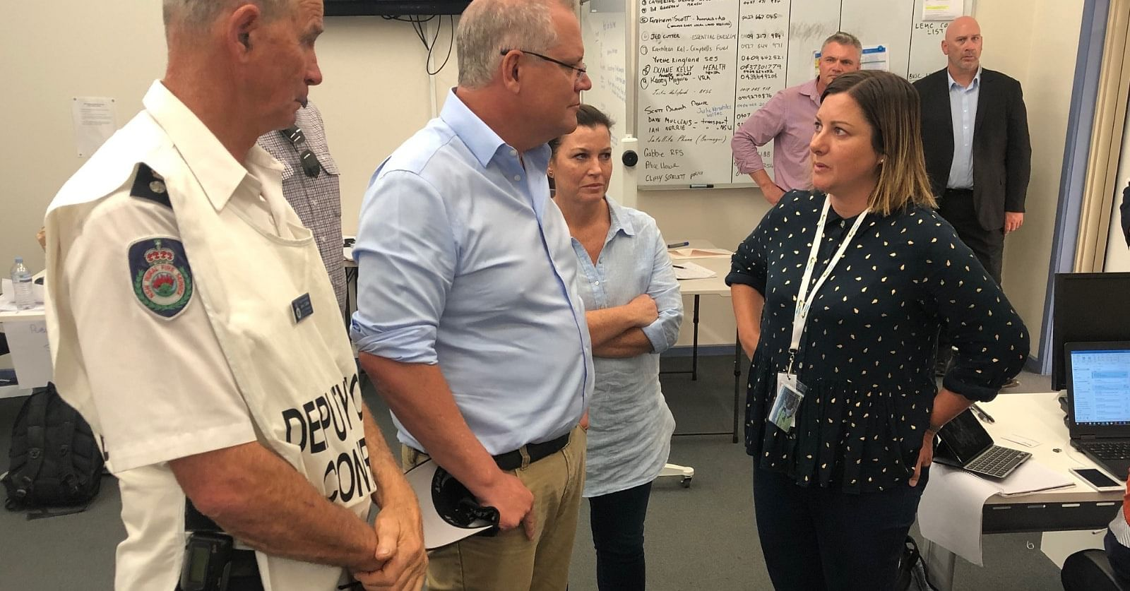 Photo: Mayor Kristy McBain speaks with Prime Minister Scott Morrison during the height of this summers bushfire emergency, watched on by Jenny Morrison and Superintendent John Cullen from Far South Coast Rural Fire Service.