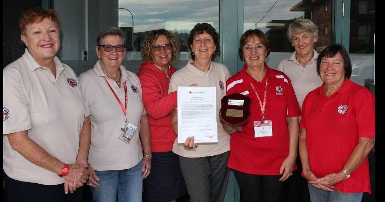 Volunteer women from Merimbula Red Cross standing together.