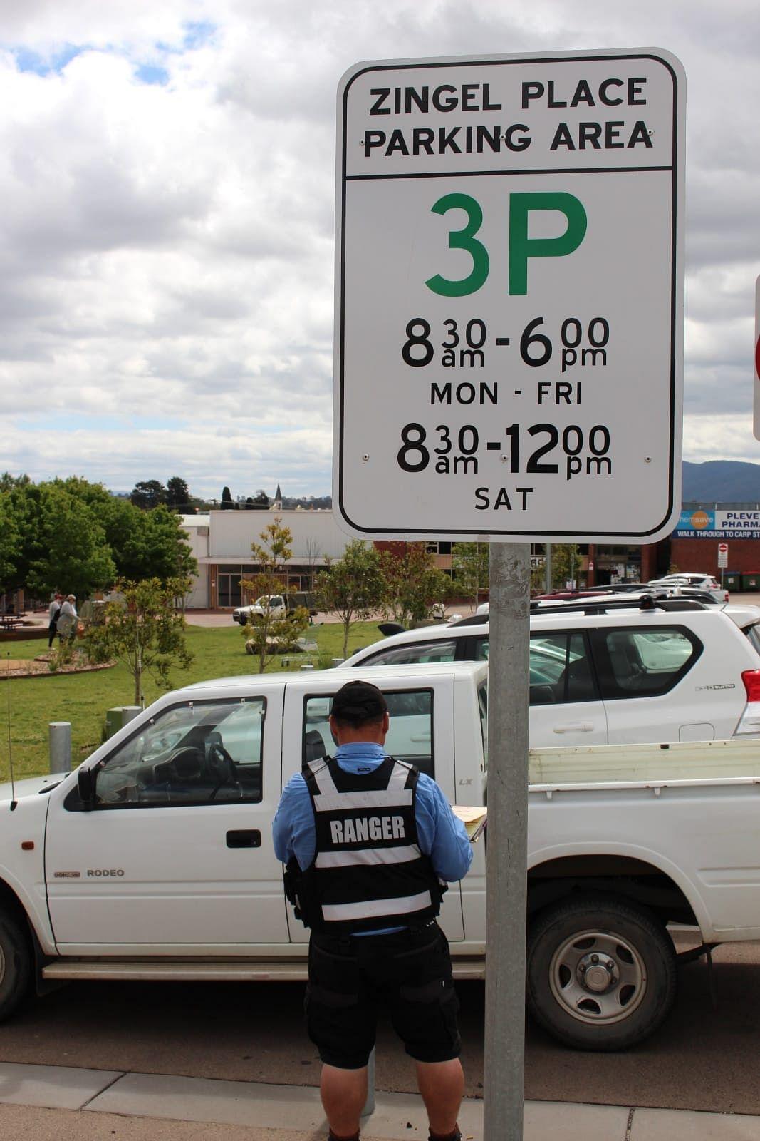 Parking ranger booking a car.