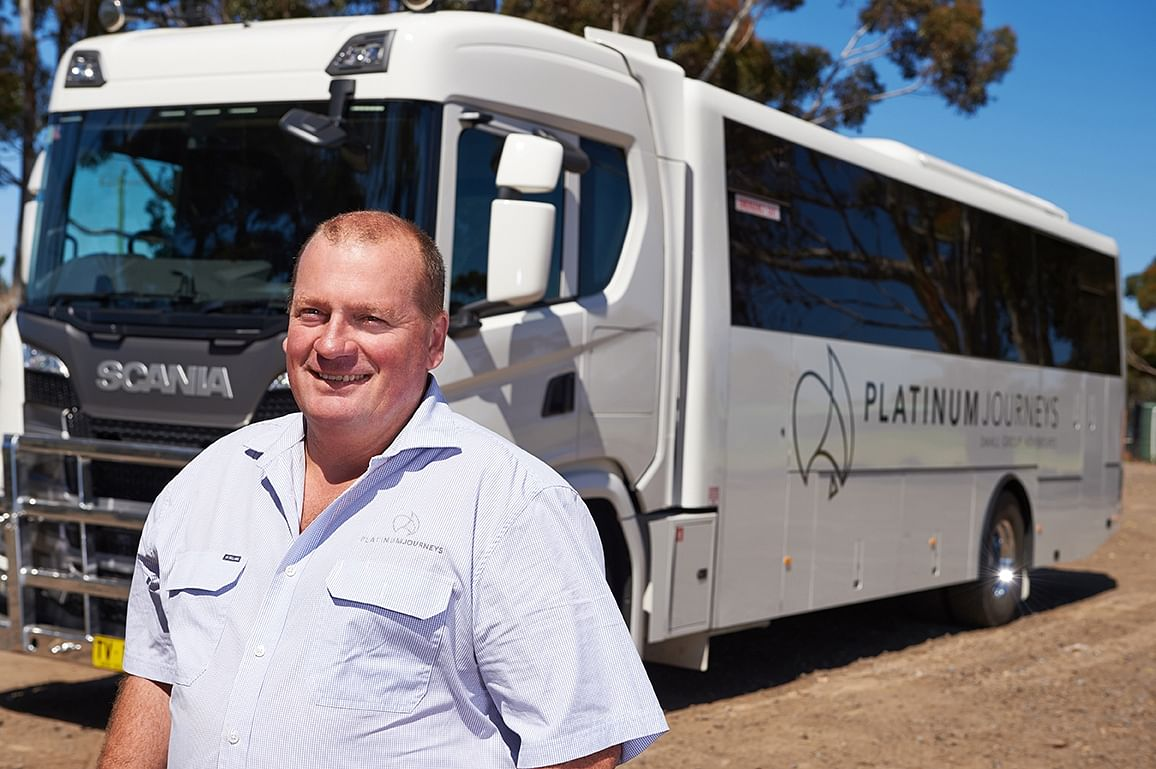 Paul Pincini standing in front of one of his new all-terrain touring buses.