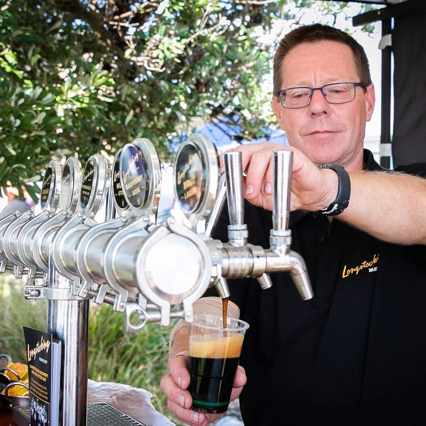 Peter Caldwell of Longstocking Brewery pours a beer.