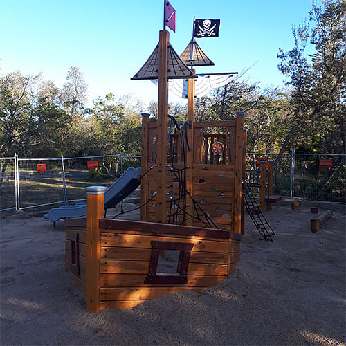 Photograph: A wooden prate ship is the feature piece in the new playground at Tathra's Lions Park. It replaces the ship that was destroyed by floodwaters during the 2016 East Coast Low event at Ray Whyman Reserve on the north of the Bega River.
