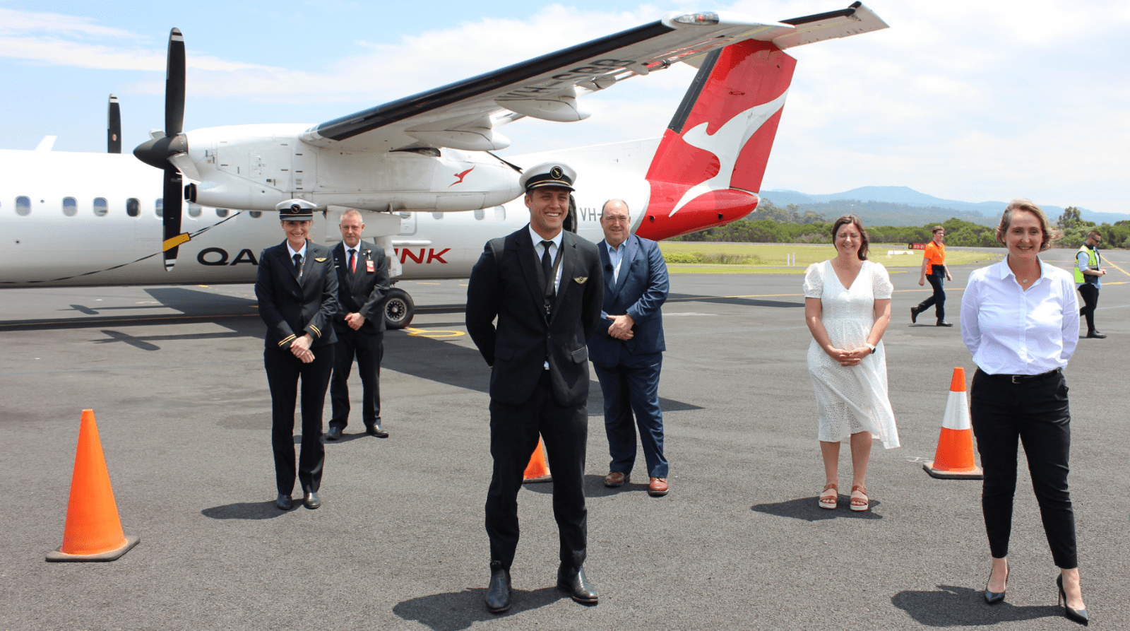 Qantas flight crew with Mayor Fitzpatrick, Member for Eden-Mondaro, Kristy McBain and Qantas Group CFO, Vanessa Hudson.