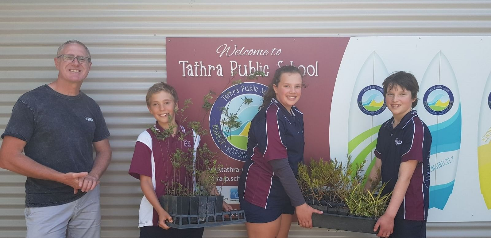 Photograph from left to right is Kevin Cassanego, Business and Program Manager, Convoy of Hope Oceania, Henry Baxter, Ava Wiggins and Nina Lauder from Tathra Public School.
