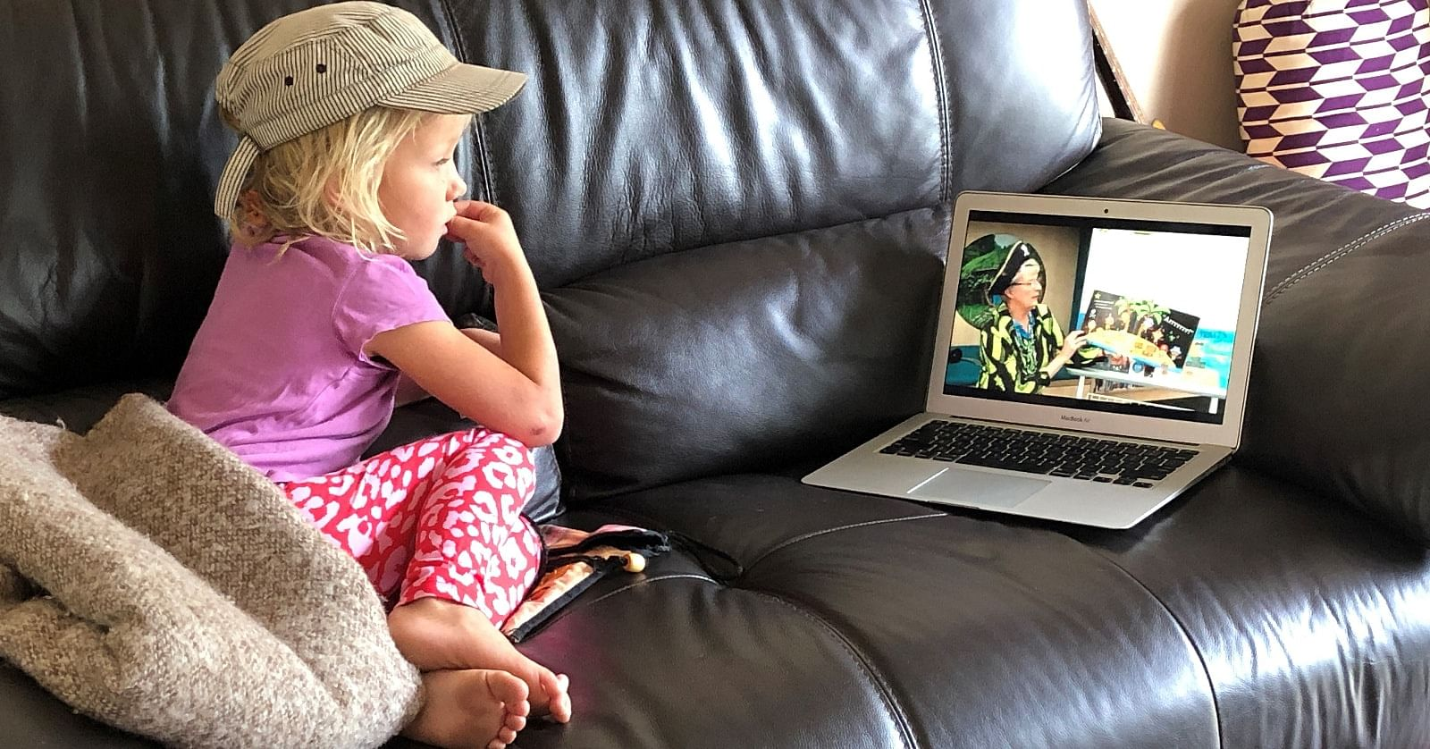 Young Lily watches Pirate Anne during a recent online Storytime.