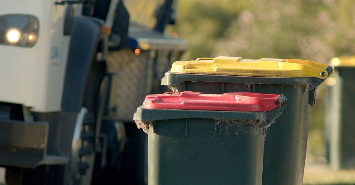 Yellow and red bins out for collection.