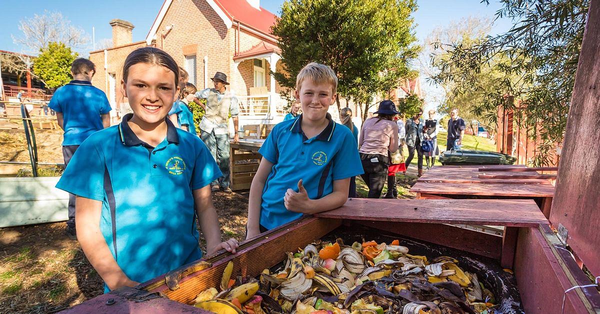 St Patrics School kids making compost.